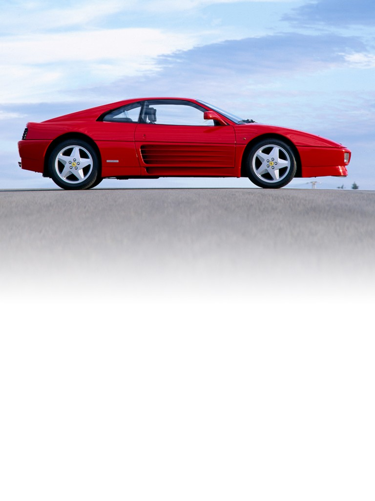 Ferrari 348 GTB: Its styling was harmonious and aerodynamically efficient, and the mid-mounted V8 engine ensured perfect weight distribution and class-beating power.