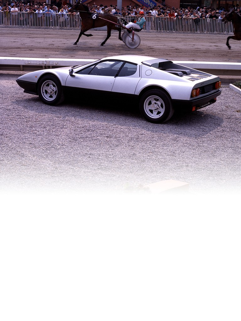 Ferrari 512 BBi: Bosch K-Jetronic mechanical fuel injection on the 512 BBi replaced the outgoing model's four, triple-choke Weber 40 IF 3C carburettors. Otherwise mechanically identical, the flat-12 featured lower maximum revs (6,600 rpm compared to the 512 BB's 6,800 rpm) and the engine developed 20 bhp less, although top speed remained within a whisker of the 512 BB's 283 km/h.